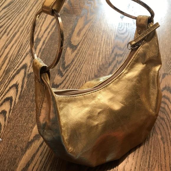 Aldo Handbags - Aldo gold leather mini pocketbook